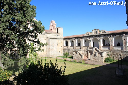 Main courtyard with the church on the left and the main entrance to the residence on the right